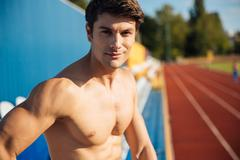 Close up portrait of a naked sexy handsome male athlete - stock photo