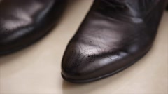 Pair of quality black leather business man shoes Stock Footage