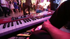 The musician plays the synthesizer in the club Stock Footage