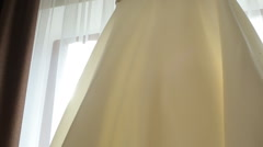 Beautifull wedding dress in the room - stock footage