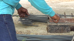 Worker bend steel line in to square shape. To construction building, Stock Footage