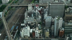 Tokyo - Aerial city view with highway traffic and Shinkansen trains. Stock Footage