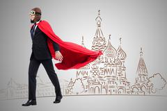Superman against the cathedral in Moscow Stock Photos