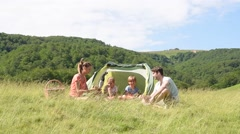 Family of four in camp tent Stock Footage