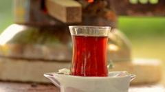 Turkish tea urn and a cup of hot turkish tea Stock Footage
