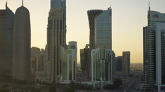 Panning across the skyline of the West Bay central financial district of Doha Stock Footage