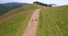 Upper view of couple riding bikes in the pyrenees Stock Footage