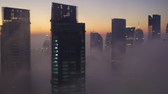 Skyline of the West Bay financial district, in early morning fog, Doha Stock Footage