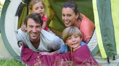 Portrait of happy family in camp tent Stock Footage