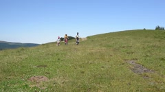 Family of four riding bikes in the mountain - stock footage