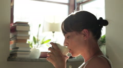 Young happy woman drinking coffee, close up HD Stock Footage