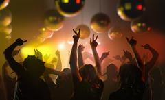 Nightlife and disco concept. Young people are dancing in club. Stock Photos