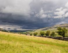 Storm clouds approaching above the Ingleton Waterfalls Trail, Ingleton, North Stock Photos