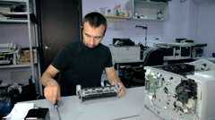 Mid shot Worker repairs electronic stuff - stock footage