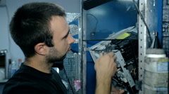 Mid shot Worker clean electronics with compressed air Stock Footage