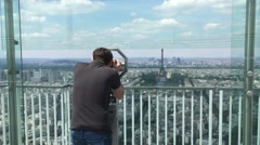Man Watches Eiffel Tower From Telescope At Montparnasse Tower, Zoom Out - stock footage