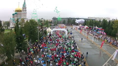 Many young people run a marathon through the streets of the beautiful city Stock Footage