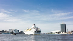 Boats, ferries and cruise ships on a busy river in Amsterdam, 4K time lapse Stock Footage