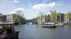 Boats in the famous canals of Amsterdam, UNESCO world heritage, 4K time lapse Stock Footage