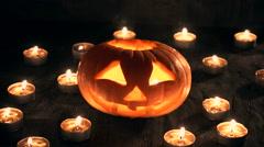 Carved Halloween pumpkin lit a flame inside, around the smoke Stock Footage