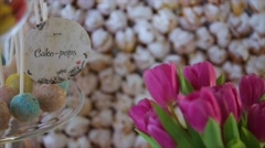 Wedding cake pops and purple tulips Stock Footage