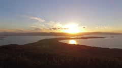 Aerial Left Pull Of Finely Point Sunset Over Flathead Lake Stock Footage