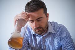 Sad man alcohol addicted feeling bad Stock Photos