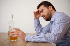 Sad man alcohol addicted feeling bad Stock Photos