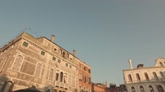 VENICE, ITALY - JUNE 19, 2016: Walking through the streets of Venice with small Stock Footage