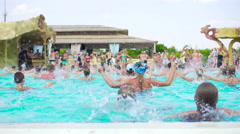 Group water aerobics at swimming pool. Wide shot Stock Footage