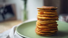 Dessert for morning breakfast. Man takes pancake from pancake stack - stock footage