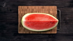 Man cuts red juicy ripe watermelon in slices with knife on dark background Stock Footage