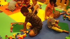 Chinese children are playing with toys. Stock Footage