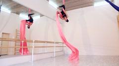 Beautiful dancer on aerial silk in studio Stock Footage