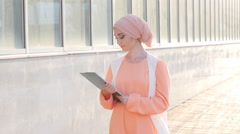 Muslim woman standing with document paper Stock Footage