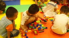 Chinese children are playing with toys. - stock footage