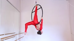 Aerial acrobat woman tricks hoop on a white background. Stock Footage
