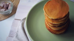 American pancakes on plate. High stack of pancakes baked for morning breakfast Stock Footage
