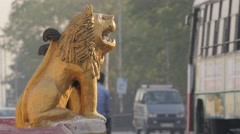Lion statue at entrance Hindu temple with traffic,Hyderabad,India Stock Footage