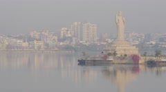 Giant buddha statue in Hussain Sagar lake with skyline,Hyderabad,India Stock Footage