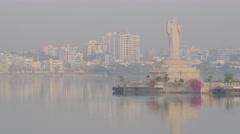 Giant buddha statue in Hussain Sagar lake with skyline,Hyderabad,India Stock Footage