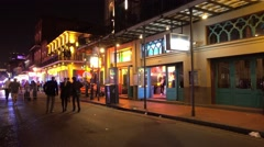Party locations at Bourbon Street French Quarter New Orleans by night Stock Footage
