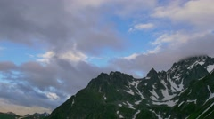 High Snowy Mountains with Clouds Evening Timelapse. Kavkaz region Stock Footage