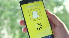 4K Snapchat app on Smartphone Loading Screen - Social Media Stock Footage