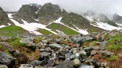 Stream in High Snowy Mountains. Kavkaz region Stock Footage