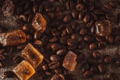 scattering of coffee beans and sugar - stock photo