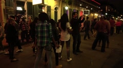 Dancing in the streets of New Orleans French Quarter Stock Footage