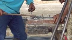 Worker bend steel line in to square shape. Stock Footage