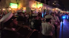 A parade through the streets in New Orleans French Quarter Stock Footage