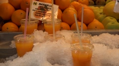 Juice drinks at the food market Mercado Central in Valencia Stock Footage